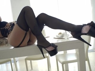 Sex-positive Romanian light-haired doll disrobing on the dining table
